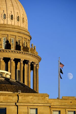 Idaho State Capitol Building governing government dome structure legal laws moon sky flags Foto de archivo