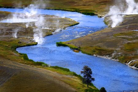 River flowing in wilderness with steam rising in Yellowstone