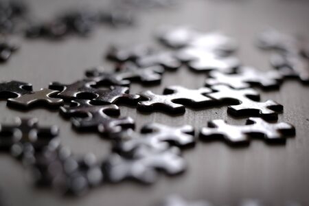 Puzzle pieces on table solving a game for fun and achievement jigsaw
