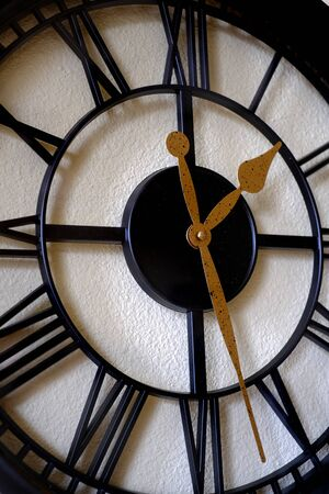 Clock on wall telling time reflection of passing of life Banco de Imagens