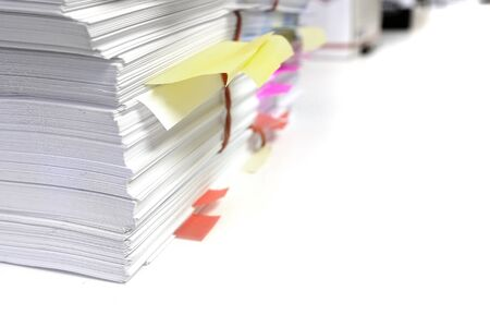 Pile or stack of papers with tags and notes for business or school