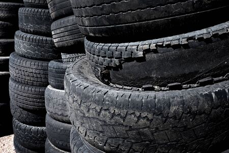 Pile and stacks of old worn used rubber tires