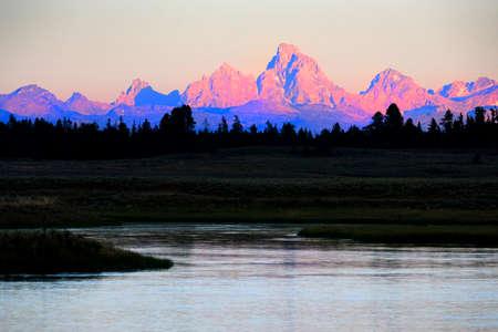 Detail of sun setting last light on Teton Mountain Range Tetons with river