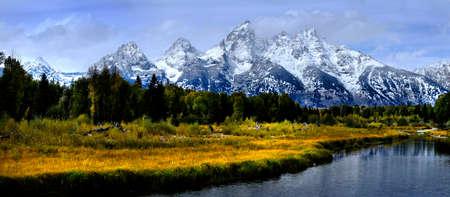 Teton Mountains Grand Teton Wilderness with river and fall autumn trees