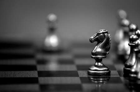 Pieces on chess board for playing game and strategy Imagens