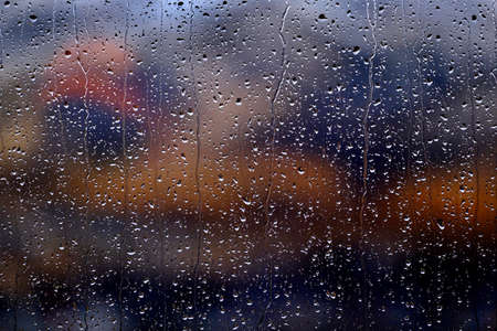 Window with rain or water drops from stormy weather