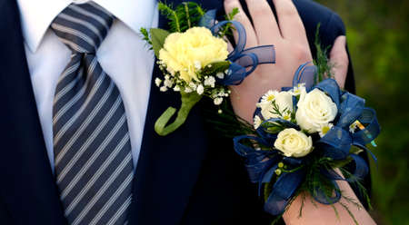 Hands of date Prom night flowers corsage formal wear hand on shoulder