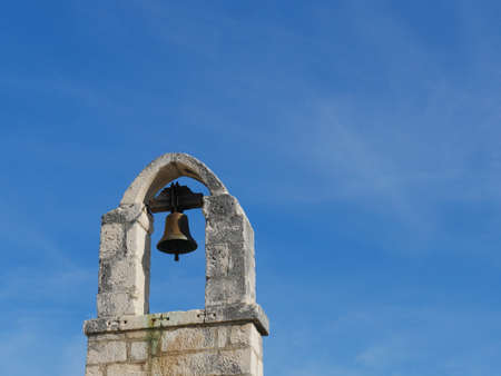 Split stone church bell tower