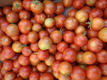 Bunch of Red-Orange Cherry Tomatos at a farmers market in San Francisco, California  photo