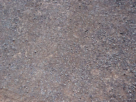 pepples: multiple gravel on the ground mutiple colorssizes.  Plus lots of dirt. Stock Photo