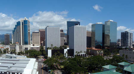 Downtown Honolulu Skyline with cars and skyscrapers.  Taken from the top of Aloha Tower with a wide angle 版權商用圖片