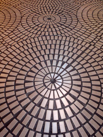 Circle tiled pattern floor with light reflecting off it.  Good for trippy background image.