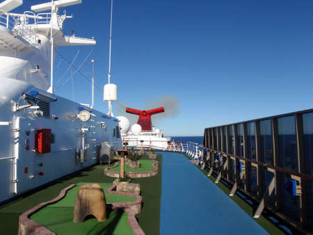 Cruise Ship Mini Golf Course on the top deck with a running track next to it. photo