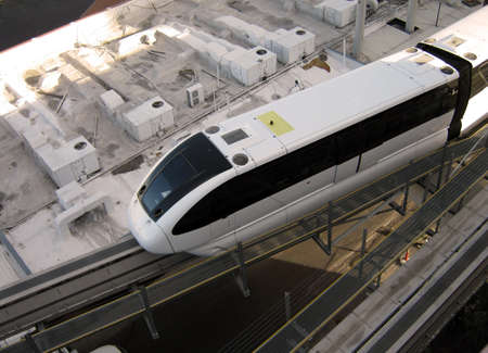 looking down at a monorail in Las Vegas pulling into station Banco de Imagens