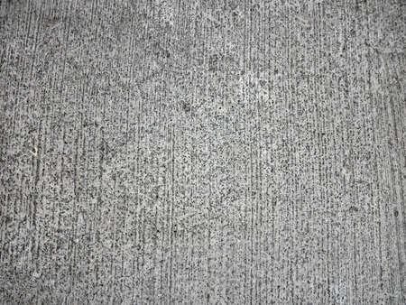 Cement Road Textured Close-Up.  With parallel lines going up and down.  Parking Garage floor.