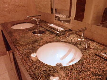 Portiat of stylistic bathroom Sinks in a fancy Las Vegas casino Stock Photo