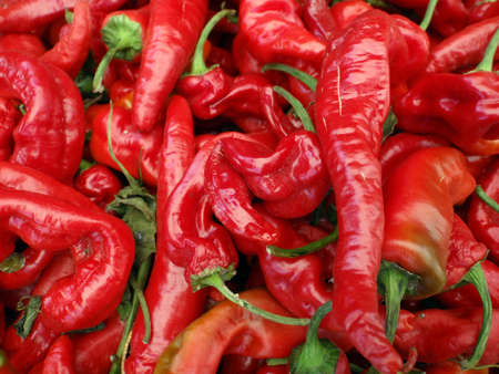 Close up of a pile of Mesilla: Cayenne-type medium to hot chili displayed at a San Franciscan farmers market Sonoma County grown.
