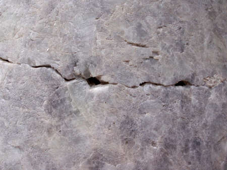 close up of cracked stone granite marble.  Crack caused by the 1906 san francisco earthquack and is found in golden gate park in a memorial. Stock Photo - 7450698