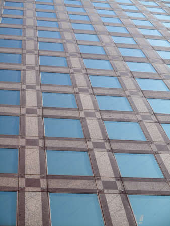 Modern Office building windows detail in San Francisco looking upwards. Good for patterns and backrounds. photo