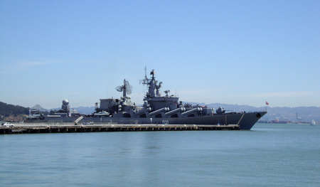 defense: Russian missile crusier Warship Varyag docked in San Francisco bay with bay bridge in the background during a friendly visit. Stock Photo