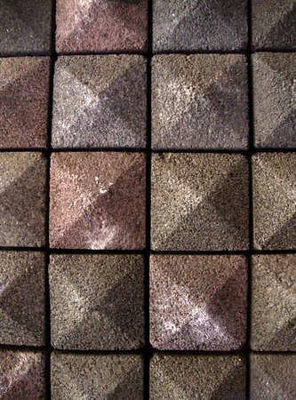 Stone tile pointed pattern of red, brown and grey shades Stock Photo - 7450751