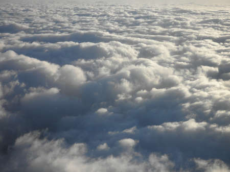 as far as the eye can see: floating above and on top of fluffy curvy clouds as far as the eye can see