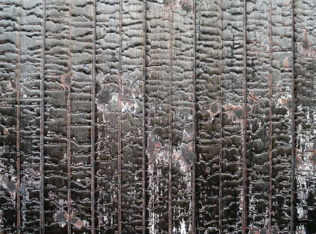 Burned painted red wood on the side on a old rail car forming a cool pattern of wear Stock Photo - 7495553