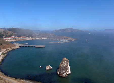 Horseshoe Bay & Fort Baker from the Golden Gate Bridge with Angel Island in the background and a light layer of fog, Marin County, California