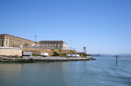 San Quentin State Prison California taken from a passing ferry.  Richmond Bridge can be seen in the background. photo