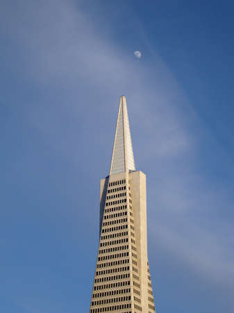 Transamerica Skyscaper in San Francisco with the moon hanging overhead during the early evening Stock Photo - 7495253