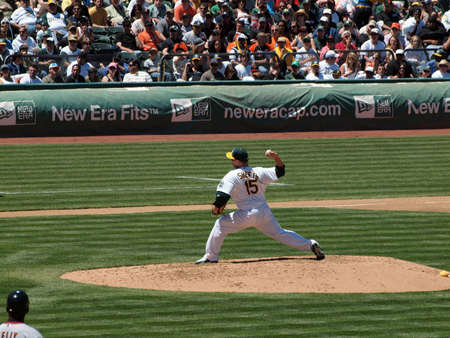 Giants 0 Vs. Athletics 3: Athletics Ben Sheets holds baseball as he steps forward to throw a pitch.  Taken May 23 2010 at the Coliseum Oakland California. Editorial