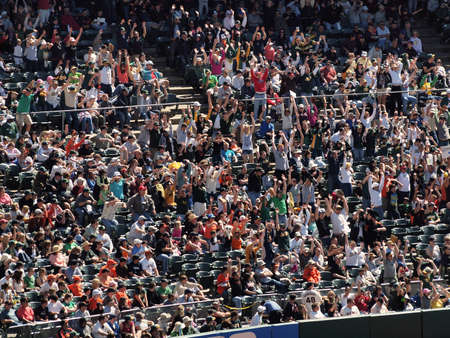 San Francisco Giants 0 Vs. Oakland Athletics 3: Oakland Athletics fans do the wave during the late innings to stay entertained.  Taken May 23 2010 at the Coliseum Oakland California. Editorial