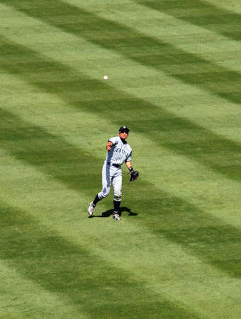 outfield: Ichiro Suzuki, Seattle Mariners throws ball from the outfield.  Oakland coliseum, California April 9, 2010