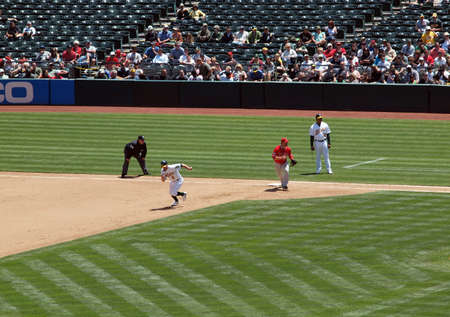 homer: As vs Angels: As Cliff Pennington breaks into run to steal second.  June 10 2010 Oakland coliseum California