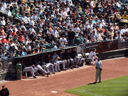 San Francisco Giants 0 Vs. Oakland Athletics 3: Giants bullpen sits by waiting for a chance to get in the game with a small canopy protecting them from the sun.  Taken May 23 2010 at the Coliseum Oakland California.