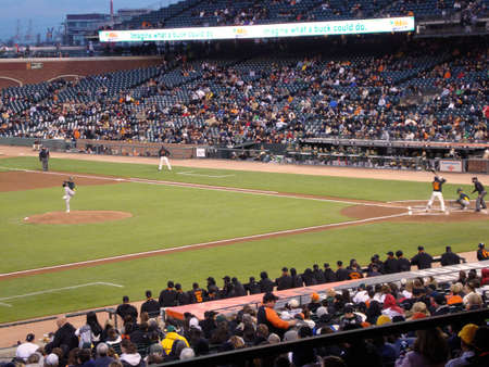 diamond plate: San Francisco Giants vs. Oakland As: Edgar Renteria waits for a pitch during a exhibition night baseball game, taken at At&T Park San Francisco on April 1, 2010.