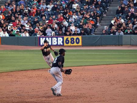 baseman: Giants Vs. Marlins: Marlins Shortstop Hanley Ramirez and second baseman  Dan Uggla move to get ball.  July 28  2010 Att Park San Francisco California.