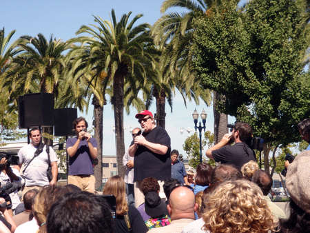 filmmaker: Filmmaker Michael Moore speaks in front of crowd at Justin Herman Plaza in San Francisco to promote a new movie and his causes.  Taken September 17 2009 in San Francisco Editorial