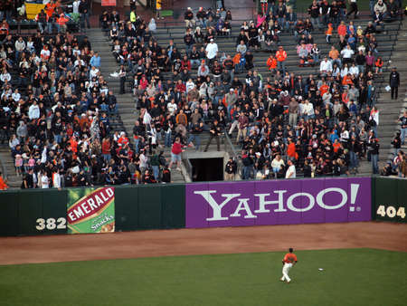 orioles: Giants Vs. Orioles: Giants Fan stretches for a homerun ball as the left field watches the back fly out of the field.  June 14 2010 Att Park San Francisco California Editorial
