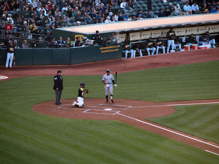 Yankees 6 vs A's 2:  Yankee Alex Rodriguez adjusts himself as he steps out of the batters box and looks in the distance, with Kurt Suzuki catching.  July 7 2010 at the Coliseum in Oakland California