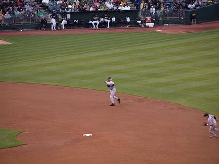 shortstop: Yankees 6 vs As 2: Yankees shortstop Derek Jeter readies to throw to 1st.  Taken July 7 2010 at the Coliseum in Oakland California