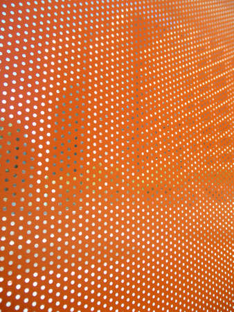 Orange sheet with open dots letting in bits of the city of San Francisco photo