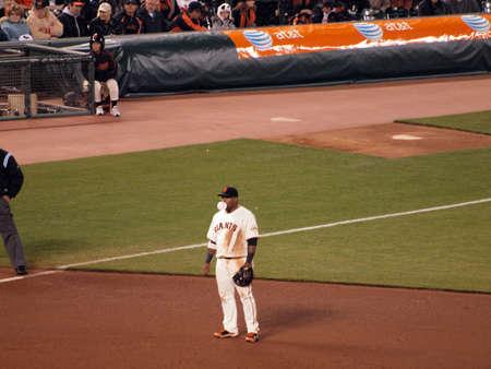 baseman: Giants Vs. Padres: 3rd Baseman Pablo Sandoval (Kung Fu Panda) blowing bubbles as he waits in between plays.  Taken May 12 2010 at Att Park San Francisco California Editorial
