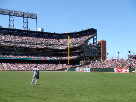 Dodger vs. Giants: Dodger outfielders stand around between plays at ATT park, Garret Anderson closest player.  Taken from free section under right field on July 31, 2010 Att Park in San Francisco. Stock Photo - 7660031