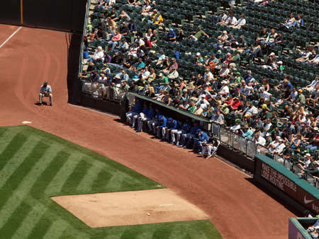 royals: Royals vs. Athletics: Kansas City Royals pitchers sit the the bullpen with fans sitting behind them. .  Taken on August 4 2010 at Coliseum in Oakland California. Editorial