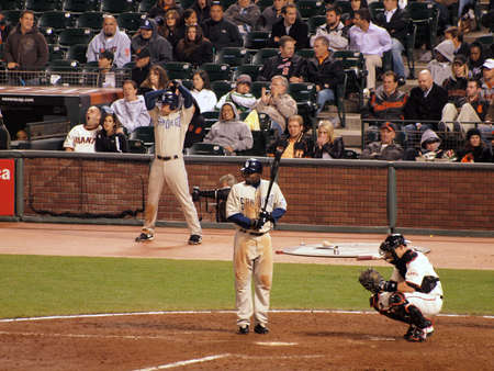 Giants Vs. Padres: Padres Tony Gwynn Jr. steps into the batters box with Eli Whiteside catching during a night game.  Taken May 11 2010 at Att Park San Francisco California Editorial