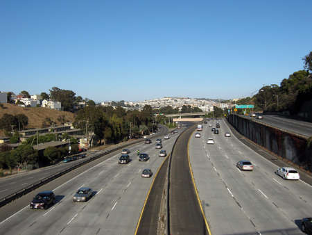 San Francisco Multi-leveled Highway with cars racing by on the 280.  Taken from a highway overpass in late afternoon traffic August 22 2010 Mission San Francisco CA.