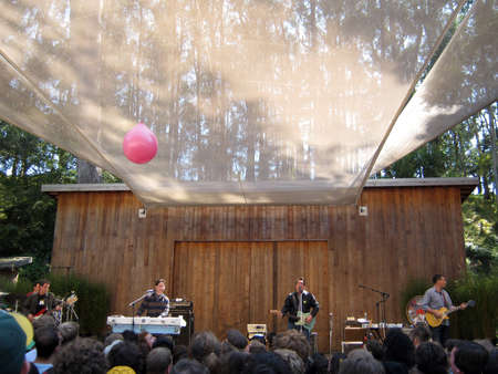 might: 73rd Stern Grove Festival:  They Might Be Giants preforms during the opening act to a large crowd at outdoor concert with pink balloon flying though the crowd.  August 22 2010 San Francisco CA. Editorial