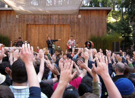 73rd Stern Grove Festival: Fans raise hands in the air during a song by They Might Be Giants at outdoor concert. August 22 2010 San Francisco CA. Editorial