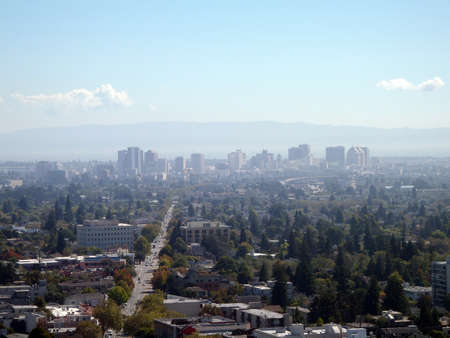 campanile: Downtown Oakland Skyline seen from the Campanile with major road leading to it in view. Stock Photo